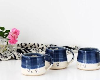 Ceramic mug with lambs glazed in blue and white - handmade stoneware pottery