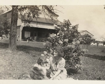 vintage photo Flapper Era 1922 Woman by Flowers House Looks at Her Border Collie Dog