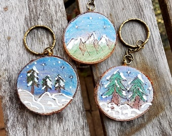 Nature themed keychains or gift tag/ornaments, wood burned designs, live edge birch slices, Fir, 3 pines and mountains, your choice