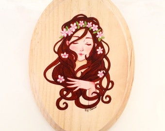 Girl with flowers. Art on the wood.