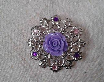 purple flower on silver charm brooch