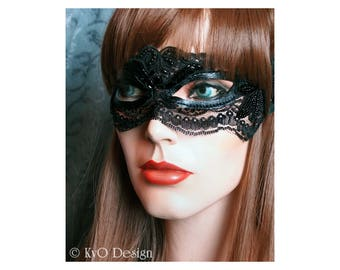 Beautiful beaded black lace mask filled with drama and mystique! Add sophistication to Halloween, New Year's Eve, Holidays and more!