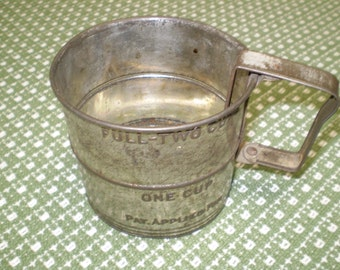 """Two cup flour sifter, 4 """" across"""