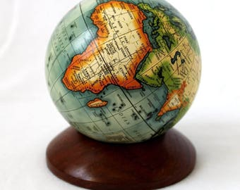 Small globe on wooden base