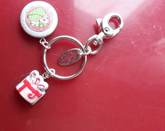 One Keychain Strawberry embellished with three charms