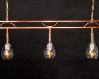 Three-light pendant lamp, made of hand-welded copper