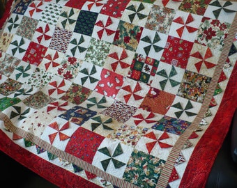 Christmas lap quilt, christmas throw quilt, red quilt, small bed quilt, 3D praire points, Xmas fabrics, handmade, red, green, blue, gold.