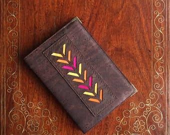 Delightful A6 plain paper notebook  covered in chocolate brown cork leather/cork fabric embellished with a laser cut chevron design