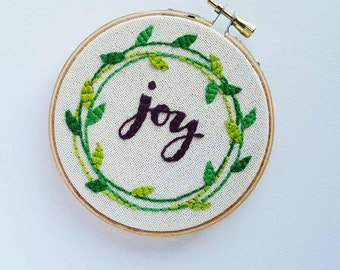 Joy embroidery hoop.