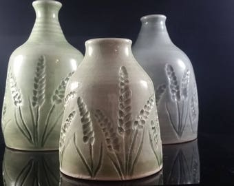 Carved porcelain bottles/vases