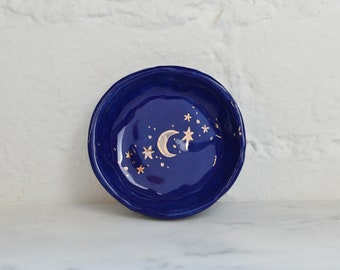 Royal blue ceramic round jewellery dish with hand painted gold lustre moon and stars. Small jewelry dish. Gift idea for her