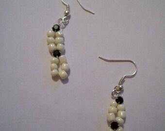White pearls and black rhinestone earrings