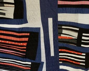 Contemporary patchwork quilt by RegressToProgress. Hand stitched. Cotton wadding.