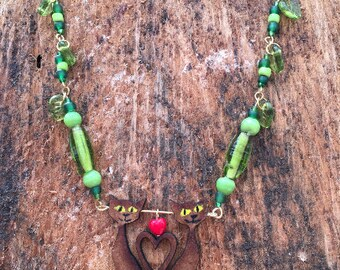 Green leaves and cat necklace
