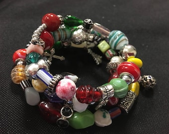 Handmade Memory wire bracelet with glass beads and charms