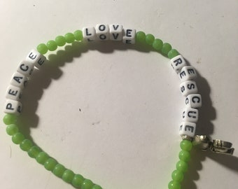 Peace Love and Rescue green bead stretch bracelet (Snoopy charm)