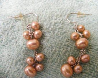 honora dangle pink pearls.