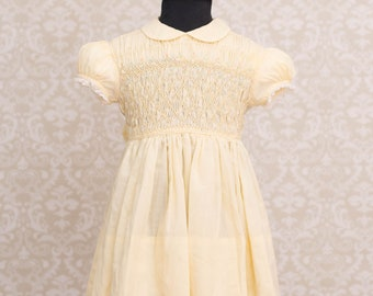 Polly Flinders Girls Hand Smocked Pale Yellow Dress