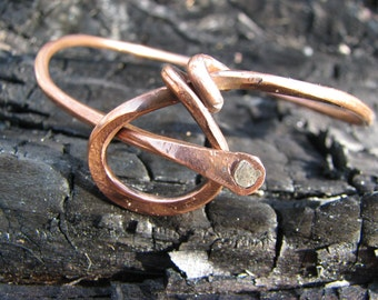 Copper bangle with silver rivet
