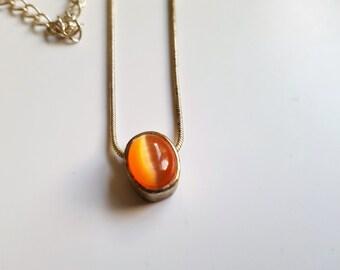 Vintage necklace silver tone metal with pendant of cream & orange stone
