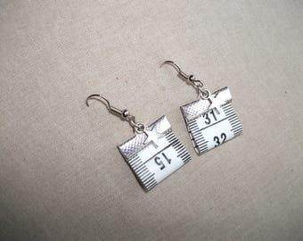 white tape measure earrings