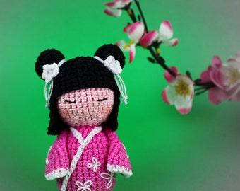 Amigurumi Kokeshi Doll Pattern : Japanese kokeshi with black hair in pink kimono crochet