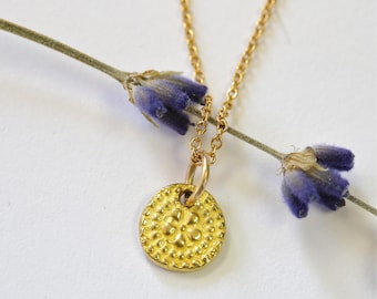 Tiny 22 Karat gold pendant with delicate GF chain