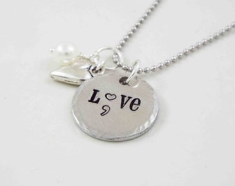 Love, semicolon, stamped metal necklace with charms.