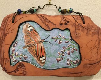 Butterfly with red clay