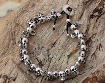Silver spinner skulls  bracelet. Rocker style. Gothic style. Mystical style. Biker style. Skull jewelry.  Skull bracelet. Leather bracelet.