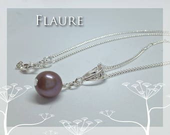 Silver necklace and pearl of purple chocolate culture