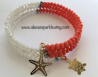 White and Coral Memory Bracelet with Starfish & Turtle Charmss/ Pulsera Memoria Blanca y Coral con dijes Estrella de Mar y Tortuga