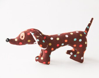 Toy dachshund. Cotton dog toy for baby game or symbol gift. Soft brown toy dog. Little pet for baby room.
