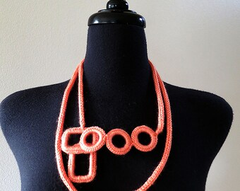 Coral Color Statement Knitted Cord Bib Necklace Lariat with Crocheted Rectangles and Rings