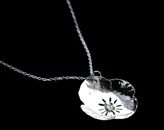 Sterling silver poppy pendant.