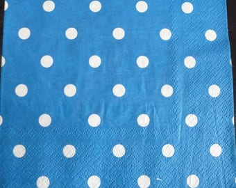 Blue napkin with white polka dots