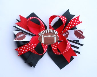 YOU CHOOSE your favorite football team colors .. beautiful layered football over the top bow on an alligator clip