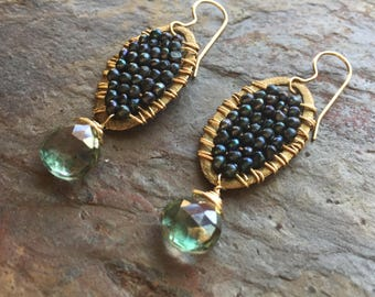Gold hoop statement earrings with freshwater pearls and a green quartz gemstone
