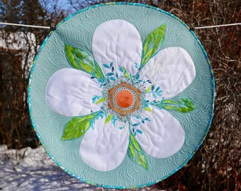 MarveLes Jumbo Apple Blossom Floral Round Quilted Table Topper Home Decor in white satin on Aqua Blue Shimmer fabric