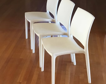 Set of three modern plastic dining chairs