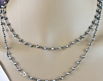 Delicate hand-made necklace with gemstones: pyrite
