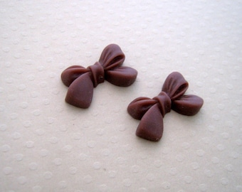 Set of 2 bows drilled resin chocolate 23 x 14 mm - NR 0383