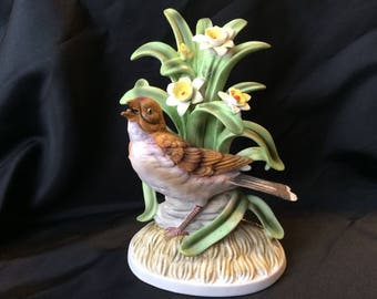 Nesting nightingale with daffodils vintage Norleans porcelain bisque figurine
