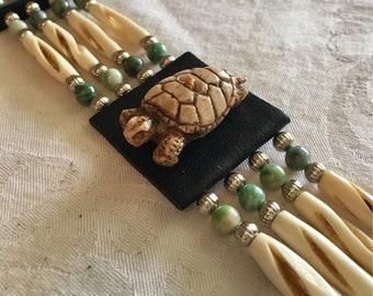 Faux Ivory carved turtle, antiqued cut bone hair pipe, black deerskin leather, native style choker, hairpipe, fancy cut, green tree agate
