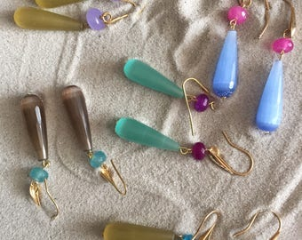 Earrings with drops of hard stones.