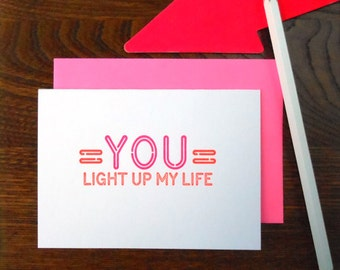 letterpress love neon sign greeting card fluorescent pink & red ink on bright white paper you light up my life