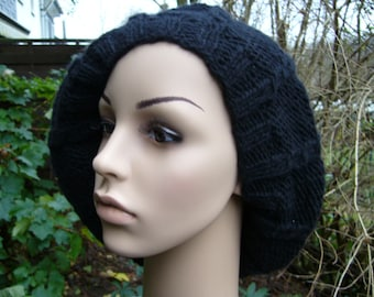 Large black balloon hat with cable pattern