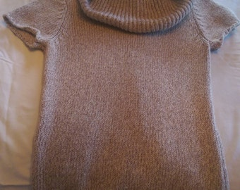 Soft and warm,tight knit,multi-colored beige sweater is small size,with a large neck,short sleeves and ribbed trim on bottom of the sweater