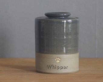 custom urn. gold infilled stamp with ceramic lid, straight shaped urn with custom stamp. modern simple urn for ashes. funerary urn. slate