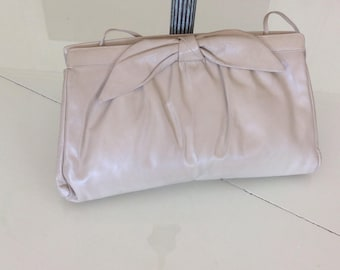 Vintage Beige Leather Clutch/Handbag with bow , by Morris Moskowitz.